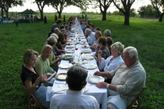 Host an outdoor potluck dinner emphasizing local food