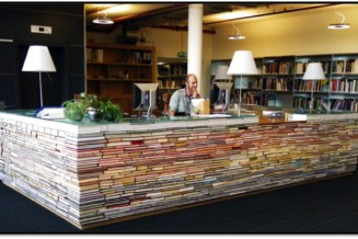 A reception desk made of old books