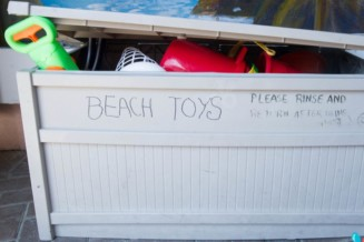 Put together a toy box of shared beach toys for Lakeside Park in Alta Vista.