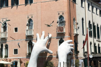 Giant hands rising from the water in Venice