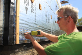 Start a home energy retrofit program implemented by local people who get skills training