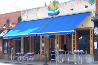 Have more buildings with awnings or canopies extend out over sidewalks.
