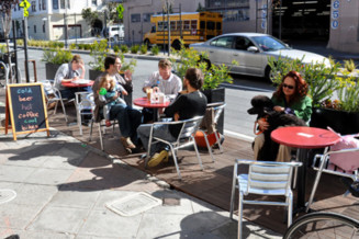 Allow coffee shops and restaurants to set up in a street parking space