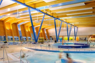 Revitalize the swimming pool – opening glass covered space with child pool and spray park