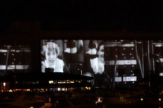 Projected digital art onto verticle SFU AQ walls during evenings