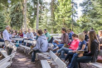 Hold public lectures outside or in open spaces (instead of classrooms or lecture halls).
